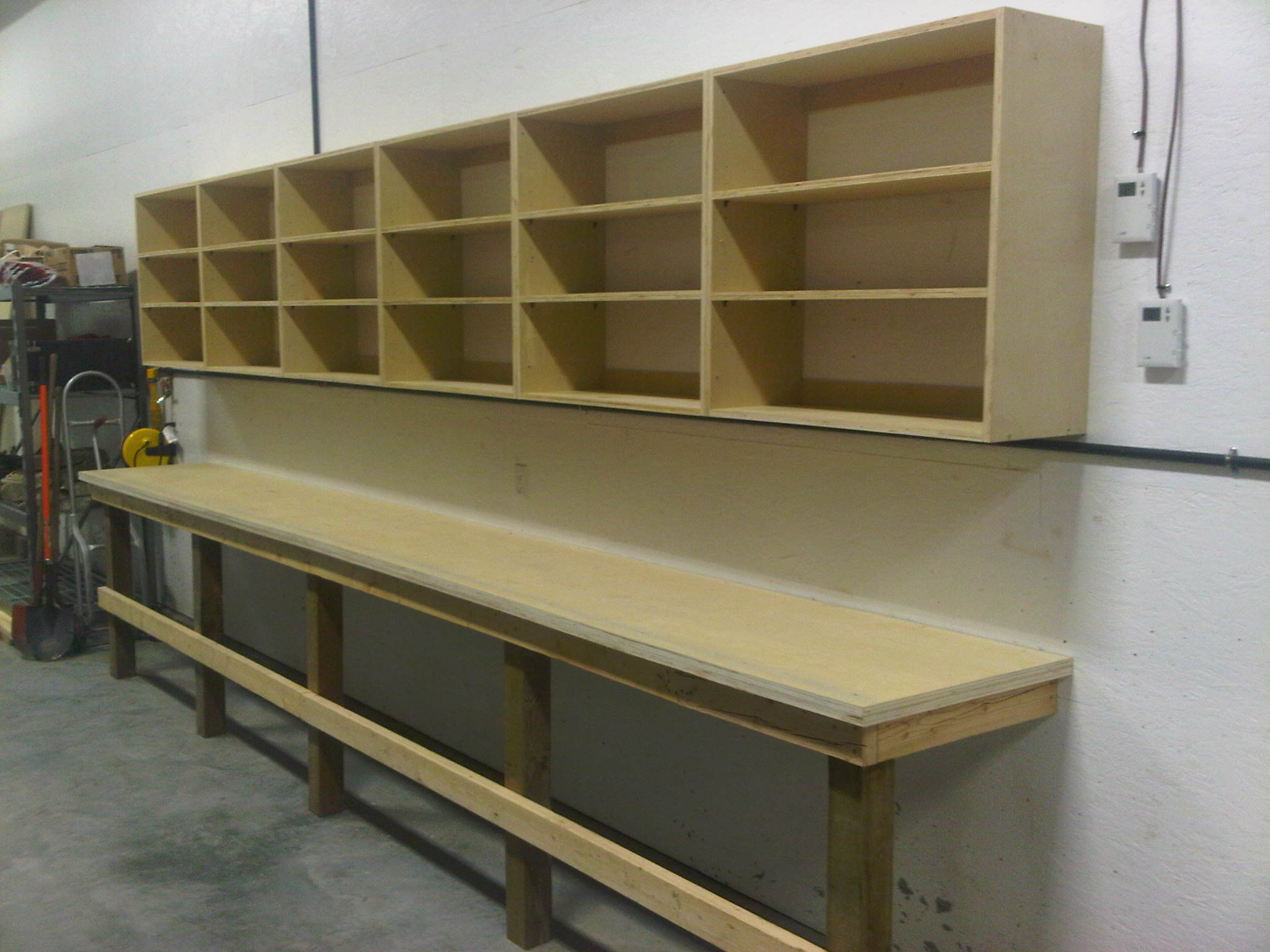 Our new workbench and shelves!